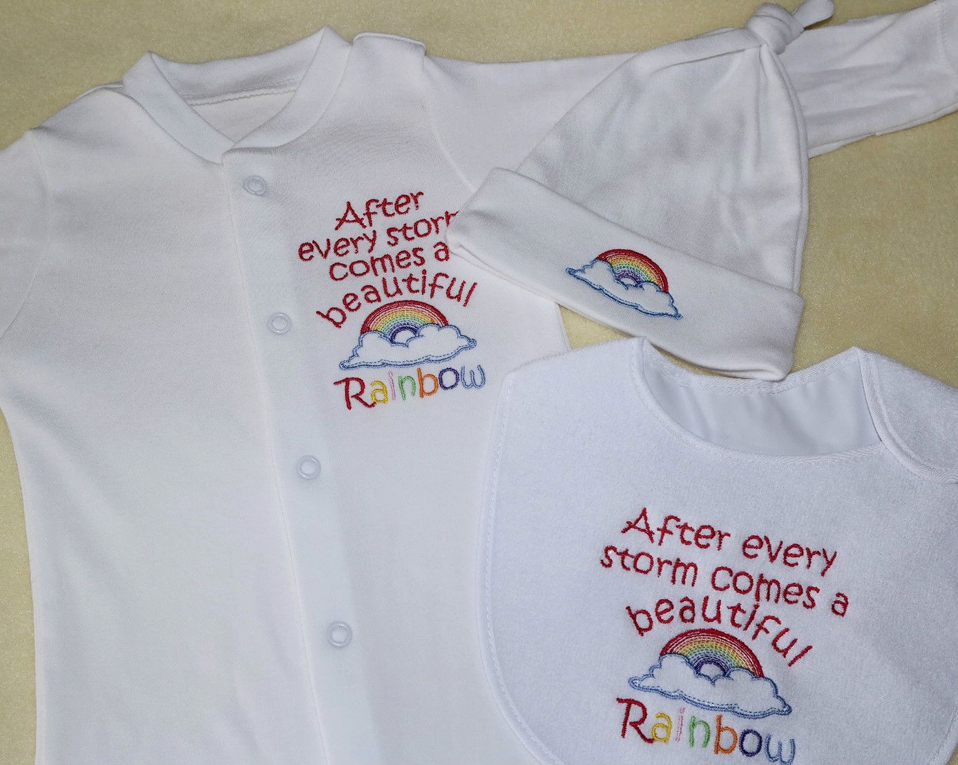 55acae67a After a storm comes a beautiful rainbow embroidered sleepsuit,bib and hat  set